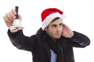 young man playing the santa bell