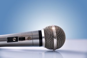 Mic on table and blue background