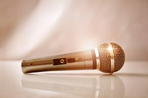 Mic with golden light on table