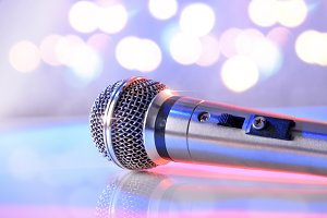 Mic on glass table pastel bokeh