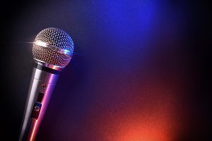 Mic on black table red blue top