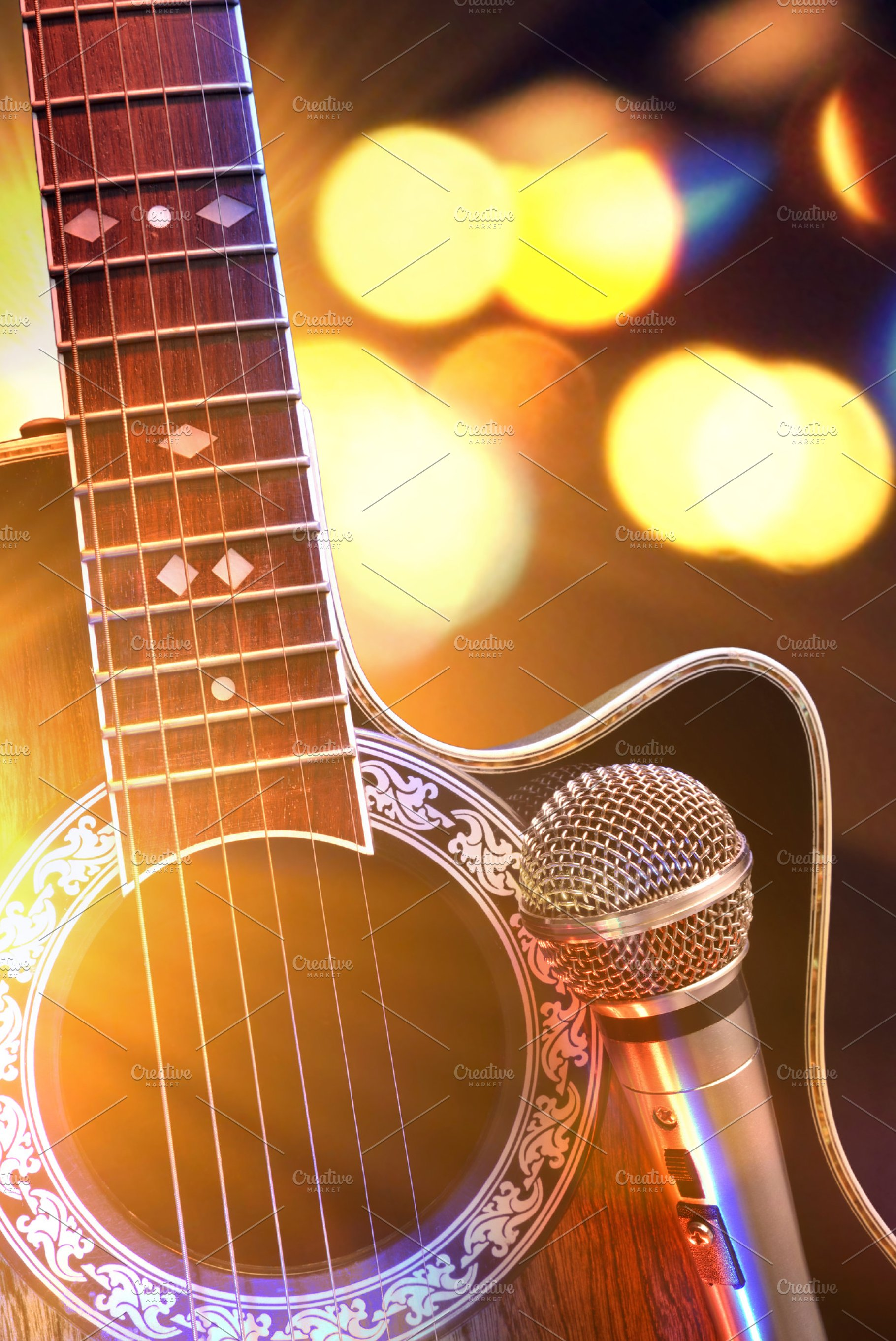 Acoustic guitar and mic with lights