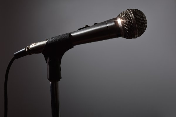 Microphone on stand in the dark