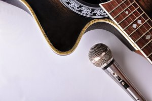 Guitar & mic on white table top view