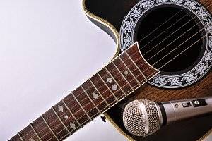 Guitar and mic on white table top