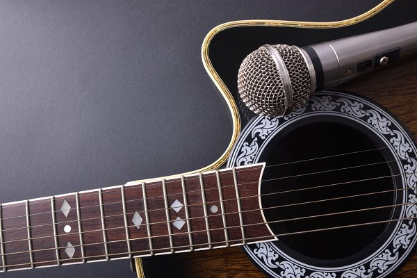 Guitar and mic on black table top