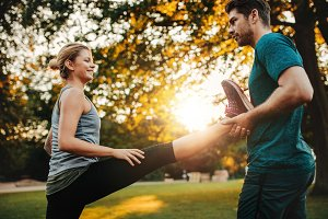 Personal trainer with woman