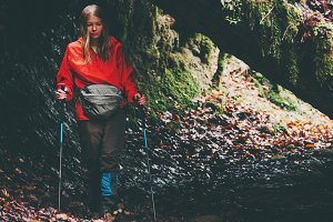 Woman Traveler hiking in forest