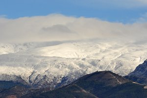 clouds, snow and mountains
