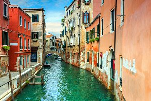 Canal with boats in Venice