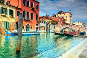 Canal with gondolas in Venice