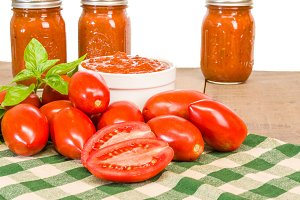 Jars of sauce with paste tomatoes