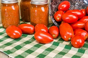 Paste tomatoes and jars of sauce
