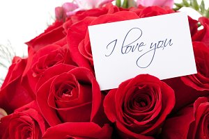 Red roses with love card