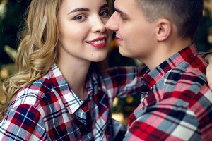 young couple boy and girl in checkered shirts