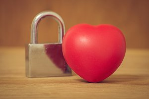 Heart of love and lock on wood