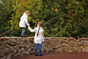 Sisters in autumn park.