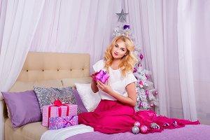 Girl preparing Christmas gifts
