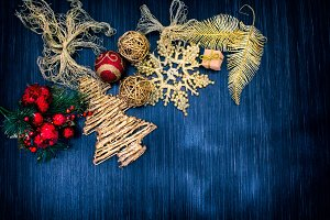 Christmas background with festive decoration and toys. Blue background.