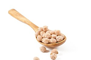 Chickpeas in wooden spoon