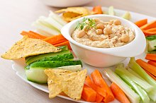 Hummus with vegetables on plate