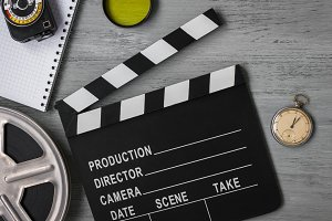 Clapperboard and film roll