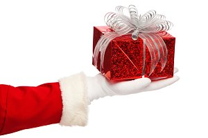 Santa claus giving  christmas present box on a white background, isolated