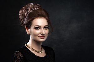 Beautiful woman on black classical dress. Vogue style photo.