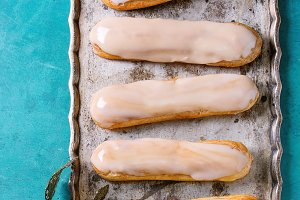 Coffee eclairs on vintage tray