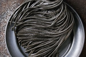Raw black spaghetti