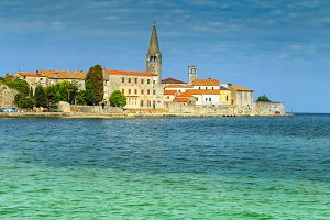 Sunny day with Porec old town