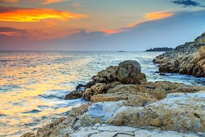 Rocky beach and colorful sunset
