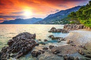 Romantic rocky beach and sunset