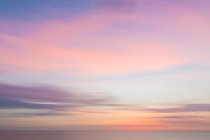 Blurred colorful sunset sky and sea