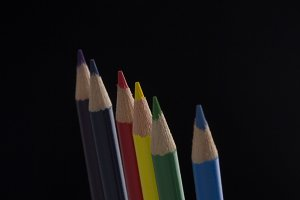 set of colour pencils isolated on black background