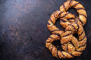 Homemade pretzel with chocolate and crunchy almonds