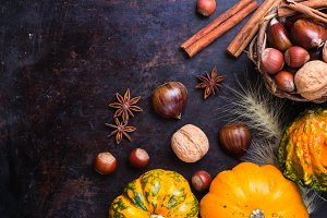 Autumn fall halloween still life composition with pumpkin nuts chestnut