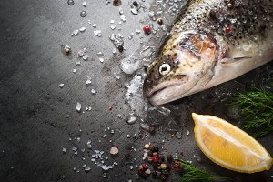 Raw brown trout on ice