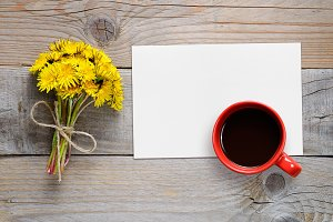 Dandelions, paper and coffee cup