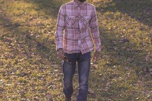 man walking park autumn grass leaves