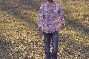 man walking park, autumn, warm color