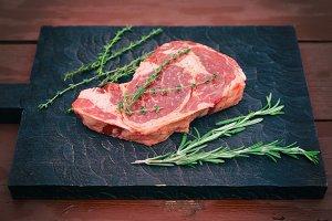 Raw rib-eye steak