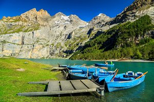 Oeschinensee lake with boats