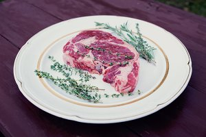 Raw rib-eye steak