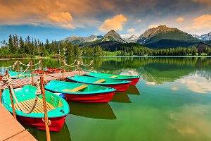 Wooden pier with colorful boats