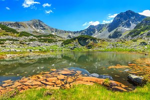 Glacier lake with colorful stones