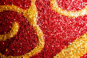 Red and gold glitter texture. Abstract close up macro.