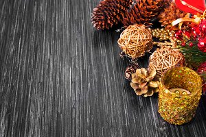 Christmas background with festive decoration and toys. Wood background.