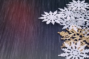 Christmas snowflakes on a wooden background.