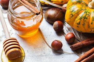 Autumn fall halloween still life composition with pumpkin nuts chestnut
